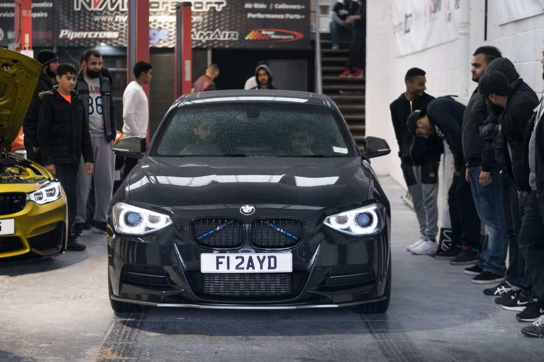 Black BMW M135i NVM front inside