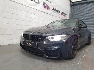 Black F83 BMW M4 at NVM front